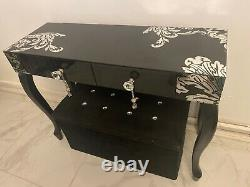 A beautiful black glass dressing table with diamond handles large wall mirror