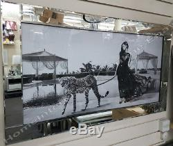 Lady in black dress walking a cheetah decor picture with crystals & mirror frame